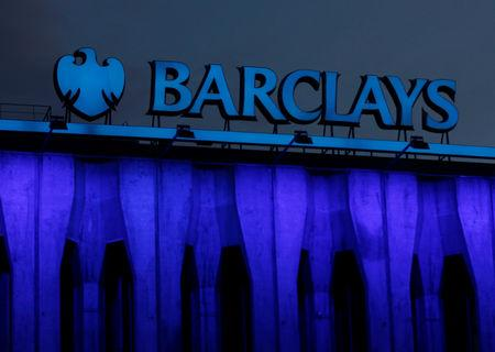 The logo of Barclays is seen on the top of one of its branch in Madrid