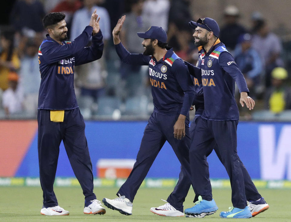 Ravindra Jadeja, center, celebrates with teammates after catching out Australia's Cameron Green for 21 runs during their one day international cricket match at Manuka Oval in Canberra, Australia, Wednesday, Dec. 2, 2020. (AP Photo/Mark Baker)