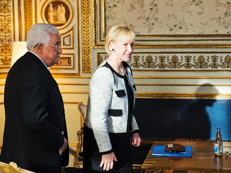 File photo shows Swedish Foreign Minister Margot Wallstroem (R) recieving Palestinian President Mahmoud Abbas at the Foreign Affairs Ministry in Stockholm on February 10, 2015