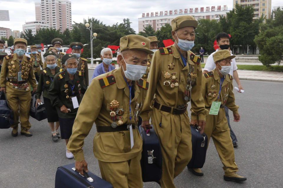 """War veterans head to a hotel to attend a national conference of war veterans on the occasion of the 67th anniversary of the end of the Korean War, which the country celebrates as the day of """"victory in the fatherland liberation war"""" in Pyongyang, North Korea Saturday, July 25, 2020. (AP Photo/Jon Chol Jin)"""