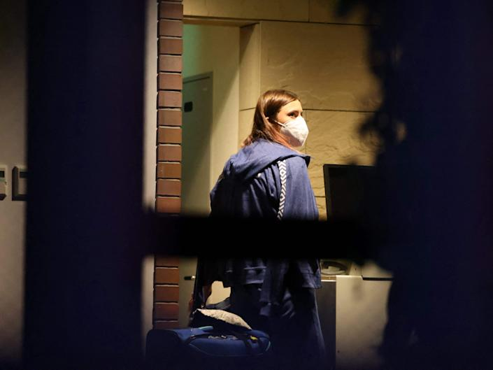 Belarus athlete Krystsina Tsimanouskaya, who claimed her team tried to force her to leave Japan following a row during the Tokyo 2020 Olympic Games, walks with her luggage inside the Polish embassy in Tokyo on August 2, 2021.