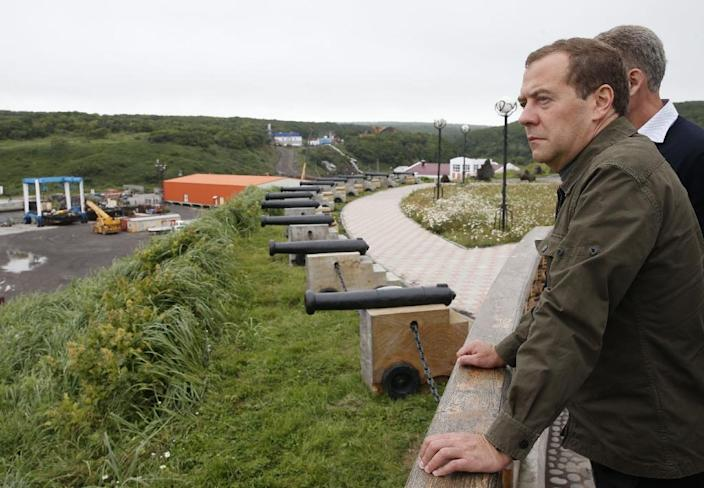 Russian Prime Minister Dmitry Medvedev inspects a port station in the Kitovyi village as he visits Iturup island, one of four islands in the chain that lies off Russia's far eastern coast and just north of Japan, on August 22, 2015 (AFP Photo/Dmitry Astakhov)