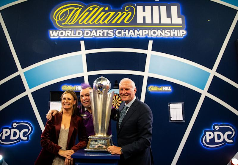 William Hill Global Brand and Marketing Director Charlotte Emery, Peter Wright and Barry Herne PDC chairmen with the Sid Waddell trophy during day sixteen of the William Hill World Championships at Alexandra Palace, London. (Photo by Steven Paston/PA Images via Getty Images)