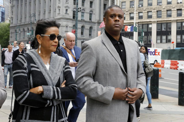 Former amateur basketball league director Merl Code, right, leaves federal court after sentencing, Friday, Oct. 4, 2019, in New York. Code was sentenced to three months in prison for his role in a college basketball bribery scheme that focused on NBA-bound athletes. (AP Photo/Richard Drew)