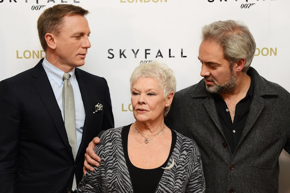 LONDON, ENGLAND - OCTOBER 22: (L-R) Daniel Craig, Judi Dench and Sam Mendes pose at a photocall for the new James Bond film 'Skyfall' at The Dorchester Hotel on October 22, 2012 in London, England. (Photo by Dave J Hogan/Getty Images)