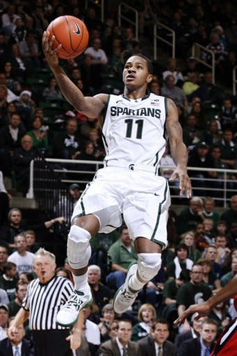 Michigan State's Keith Appling goes up for a fast-break layup against Louisiana-Lafayette during the second half of an NCAA college basketball game, Sunday, Nov. 25, 2012, in East Lansing, Mich. Appling led Michigan State with 19 points in a 63-60 win. (AP Photo/Al Goldis)