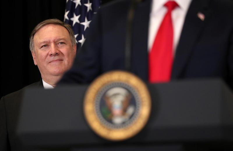 U.S. President Donald Trump is watched by Secretary of State Mike Pompeo as they take part in the swearing-in ceremony for the Central Intelligence Agency's first female director, Gina Haspel, at CIA Headquarters in Langley, Virginia, U.S., May 21, 2018.