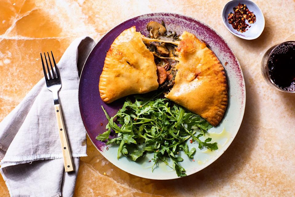 """Make a big batch of these grown-up pizza pockets and freeze the extras for some night when you're short on time. They go great with a <a href=""""https://www.epicurious.com/recipes/food/views/arugula-salad-with-lemon-parmesan-dressing-352111?mbid=synd_yahoo_rss"""" rel=""""nofollow noopener"""" target=""""_blank"""" data-ylk=""""slk:simple arugula salad"""" class=""""link rapid-noclick-resp"""">simple arugula salad</a>. <a href=""""https://www.epicurious.com/recipes/food/views/calzones-with-chorizo-and-kale?mbid=synd_yahoo_rss"""" rel=""""nofollow noopener"""" target=""""_blank"""" data-ylk=""""slk:See recipe."""" class=""""link rapid-noclick-resp"""">See recipe.</a>"""