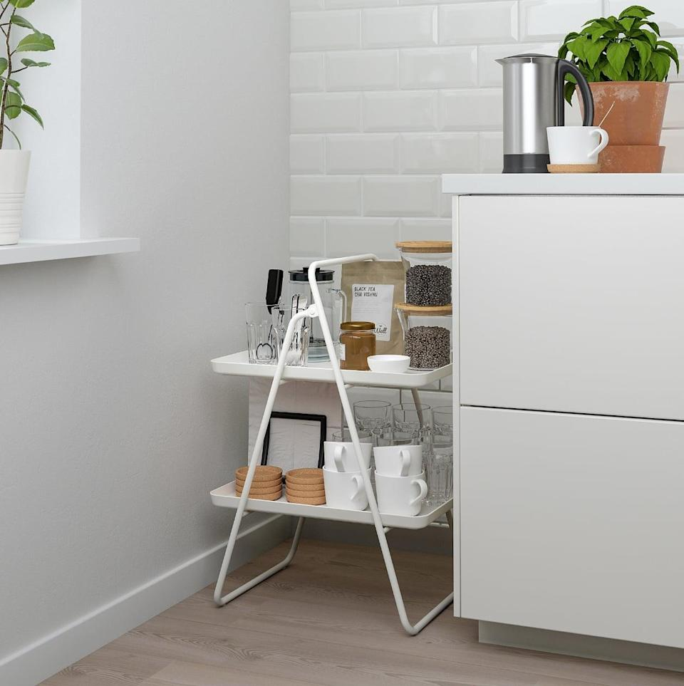 "<p>A nice place to hold any kind of kitchen necessity, the <a href=""https://www.popsugar.com/buy/Viggja%20Tray%20Stand-446994?p_name=Viggja%20Tray%20Stand&retailer=ikea.com&price=20&evar1=casa%3Aus&evar9=46151613&evar98=https%3A%2F%2Fwww.popsugar.com%2Fhome%2Fphoto-gallery%2F46151613%2Fimage%2F46152183%2FViggja-Tray-Stand&list1=shopping%2Cikea%2Corganization%2Ckitchens%2Chome%20shopping&prop13=api&pdata=1"" rel=""nofollow noopener"" target=""_blank"" data-ylk=""slk:Viggja Tray Stand"" class=""link rapid-noclick-resp"">Viggja Tray Stand</a> ($20) is easy to move, collapse, and store.</p>"