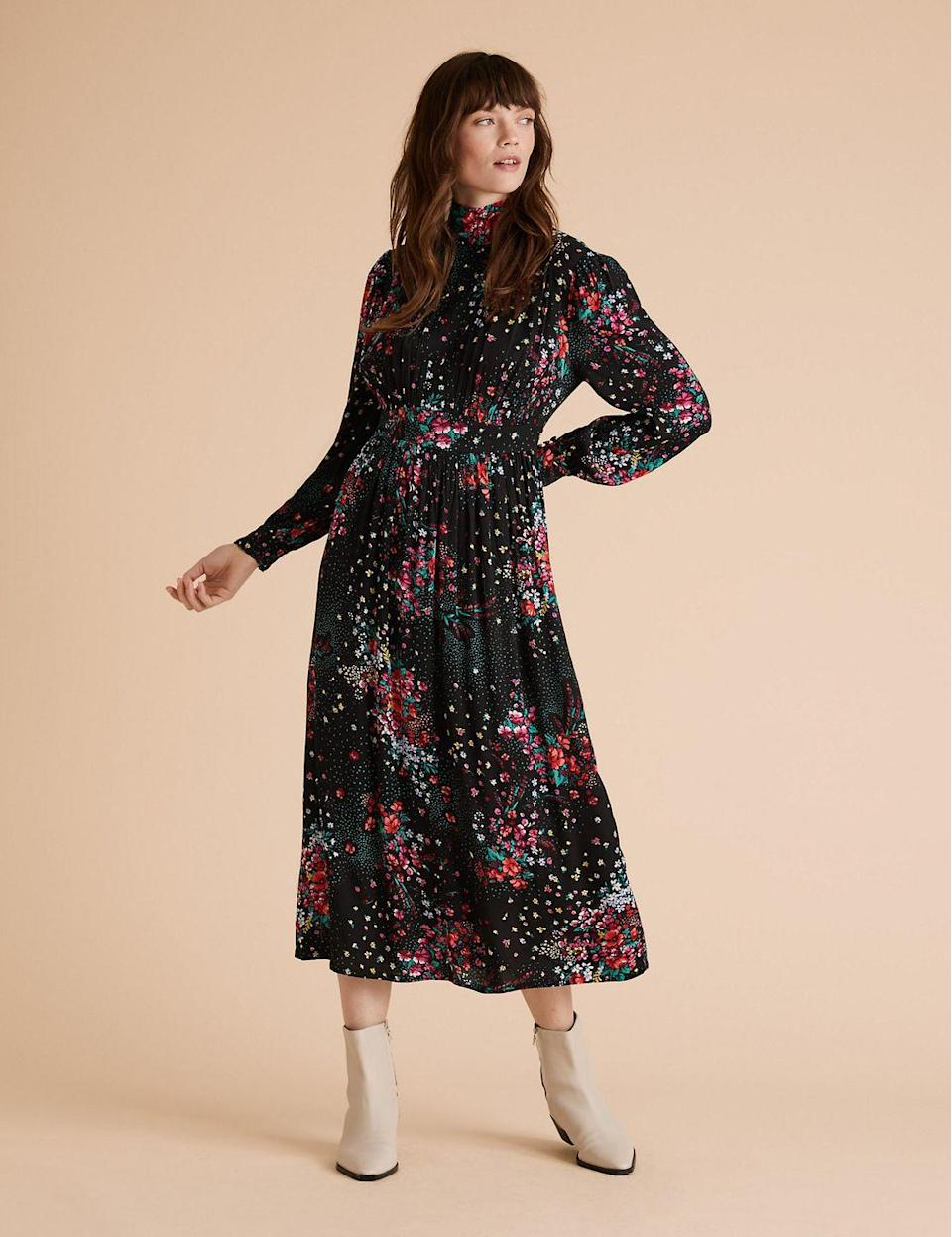 """<p><a class=""""link rapid-noclick-resp"""" href=""""https://go.redirectingat.com?id=127X1599956&url=https%3A%2F%2Fwww.marksandspencer.com%2Ffloral-high-neck-midaxi-waisted-dress%2Fp%2Fclp60474490&sref=https%3A%2F%2Fwww.redonline.co.uk%2Ffashion%2Fshopping%2Fg34625942%2Fmarks-and-spencer-womenswear-sale%2F"""" rel=""""nofollow noopener"""" target=""""_blank"""" data-ylk=""""slk:SHOP HERE"""">SHOP HERE</a> <strong>Was £55, Now £38.50 </strong></p><p>This Per Una design proves that floral prints and drapey dresses can work in the colder seasons too. Pair with tights and boots for a warm winter look. </p>"""