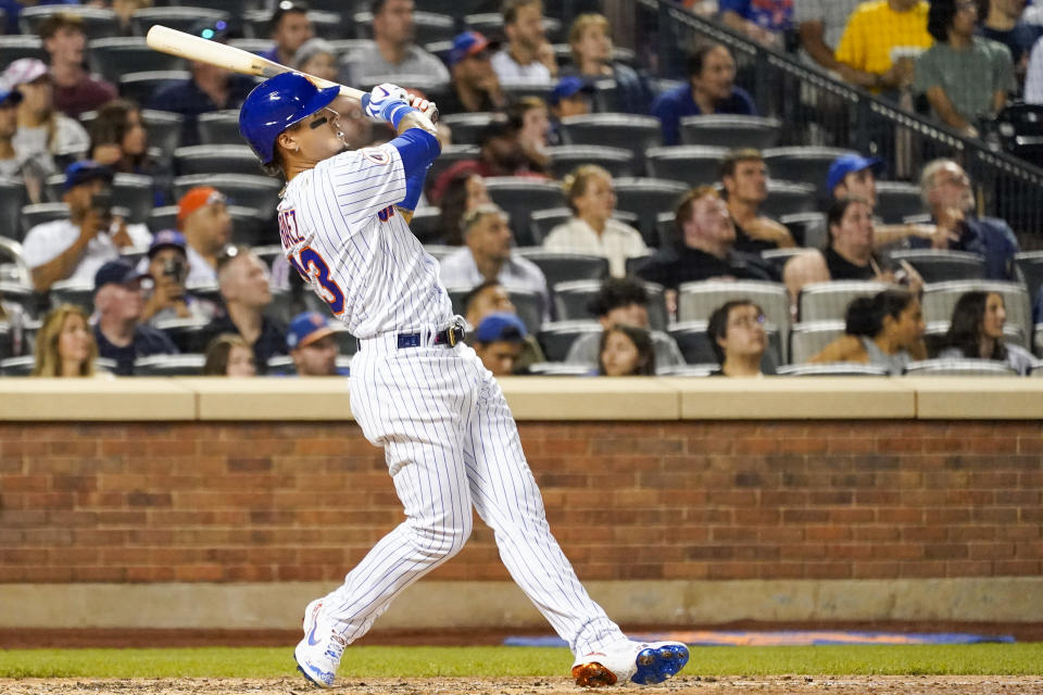 New York Mets' Javier Baez watches his two-run home run in the sixth inning of the baseball game against the Cincinnati Reds, Saturday, July 31, 2021, in New York. (AP Photo/Mary Altaffer)