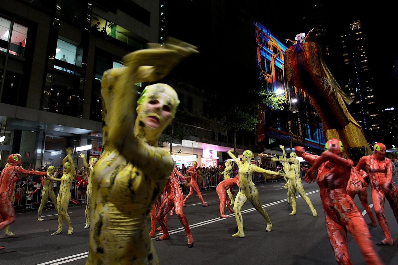 SYDNEY, AUSTRALIA - FEBRUARY 17:  Dancers perform 'Lady White Snake' during the opening ceremony of the Chinese New Year Twilight Parade along George Street on February 17, 2013 in Sydney, Australia. More than 100,000 attended the annual parade to celebrate the Chinese Lunar New Year and more then 3,500 performers took part.  (Photo by Lisa Maree Williams/Getty Images)