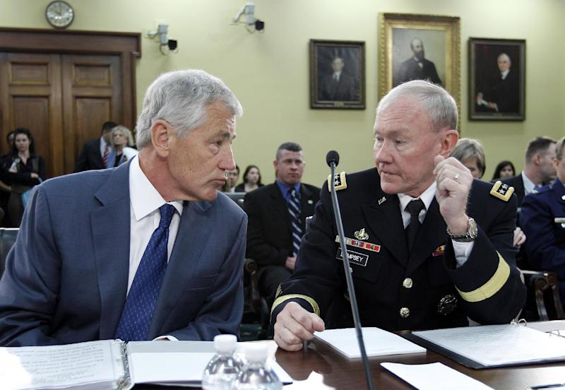 Defense Secretary Chuck Hagel speaks with Joint Chiefs Chairman Gen. Martin E. Dempsey on Capitol Hill, in Washington, Tuesday, April 16, 2013, prior to their testimony before the House Defense Subcommittee hearing on the Defense Department's fiscal 2014 budget. (AP Photo/Jose Luis Magana)
