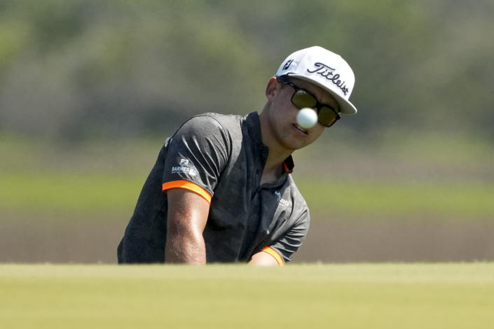 Garrick Higgo, of South Africa, chips to the green on the third hole during a practice round at the PGA Championship golf tournament on the Ocean Course Tuesday, May 18, 2021, in Kiawah Island, S.C. (AP Photo/David J. Phillip)