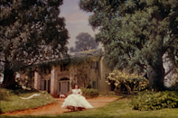 """<p>Built in a California studio instead of Georgia, the fictional O'Hara family's <a rel=""""nofollow noopener"""" href=""""https://en.wikipedia.org/wiki/Tara_(plantation)#Movie_set"""" target=""""_blank"""" data-ylk=""""slk:estate"""" class=""""link rapid-noclick-resp"""">estate</a> sat in a set back lot<span> until the 1950s, when Southern Attractions, Inc. purchased the façade. The set was deconstructed and shipped to Georgia with plans to rebuild it as the keystone piece of an amusement park. Unfortunately, that never happened - it was passed on to private owners and as far as we know, is currently deteriorating in storage. The front door, however, hangs in the <a rel=""""nofollow noopener"""" href=""""http://www.atlantahistorycenter.com/explore/destinations/margaret-mitchell-house"""" target=""""_blank"""" data-ylk=""""slk:Margaret Mitchell House and Museum"""" class=""""link rapid-noclick-resp"""">Margaret Mitchell House and Museum</a> in Atlanta.</span></p>"""