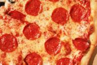 """<p>Pizza is a fan-favorite for both kids and adults, but no one really considers it healthy. So it's probably not that shocking that a <a href=""""https://www.livescience.com/49490-kids-pizza-consumption.html"""" rel=""""nofollow noopener"""" target=""""_blank"""" data-ylk=""""slk:2015 study"""" class=""""link rapid-noclick-resp"""">2015 study</a> found that it's not the best food for kids to consume. The study noted the amount of calories in pizza, and found that on the day kids eat pizza, they end up eating more saturated fat, salt, and calories overall. This is similar to what happens when kids eat fast food.</p><p>To keep pizza as part of their diet, make your own instead of ordering out. You can also add veggies to the pizza, limit the cheese and oil, and serve it with a side of vegetables. </p>"""