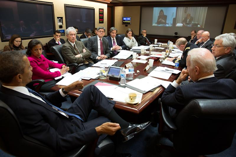 In this image released by the White House, President Barack Obama, left, convenes a National Security Council meeting in the Situation Room of the White House to discuss matters in Ukraine, on Monday, March 3, 2014, in Washington. At right is Vice President Joe Biden. (AP Photo/The White House, Pete Souza)