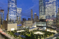 """FILE - The National September 11 Memorial and Museum, bottom, is surrounded by high-rise towers on Sept. 8, 2017, in New York. Museum officials have objected and sought changes to """"The Outsider,"""" a documentary being released this week that reveals disputes that went into development of the Sept. 11 memorial and museum, which opened in 2014. (AP Photo/Mark Lennihan, File)"""