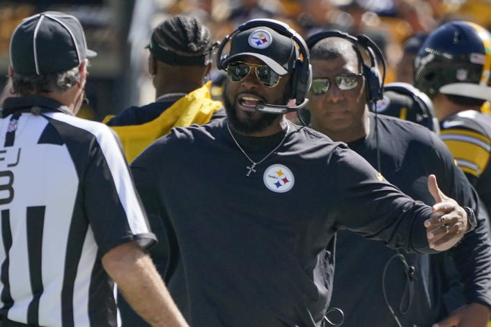 Pittsburgh Steelers head coach Mike Tomlin, front right, complains to an official during the first half an NFL football game against the Cincinnati Bengals, Sunday, Sept. 26, 2021, in Pittsburgh. (AP Photo/Gene J. Puskar)