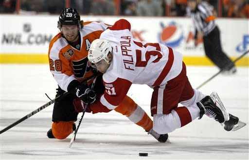 Philadelphia Flyers center Claude Giroux (28) and Detroit Red Wings center Valtteri Filppula (51), from Finland, go for the puck in the second period of an NHL hockey game Tuesday, March 6, 2012, in Philadelphia. (AP Photo/Alex Brandon)