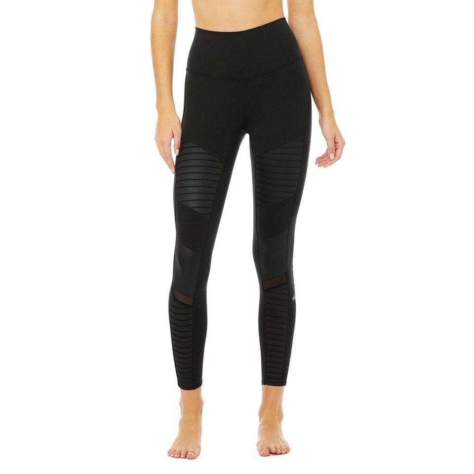 """If there were ever a time to get yourself a pair of celebrity-approved leggings, it's now. This specific style has been seen on the legs of models including Gigi Hadid, Cindy Crawford, and Hailey Bieber, among others. $114, Alo. <a href=""""https://www.aloyoga.com/products/w5767r-7-8-high-waist-moto-legging-black"""" rel=""""nofollow noopener"""" target=""""_blank"""" data-ylk=""""slk:Get it now!"""" class=""""link rapid-noclick-resp"""">Get it now!</a>"""
