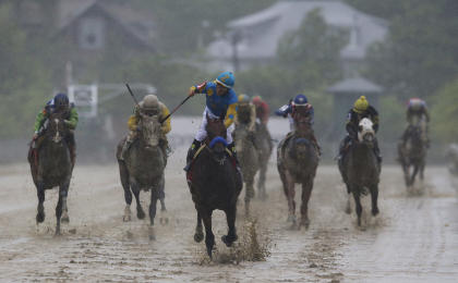 American Pharoah, ridden by Victor Espinoza, center, wins the 140th Preakness Stakes. (AP)