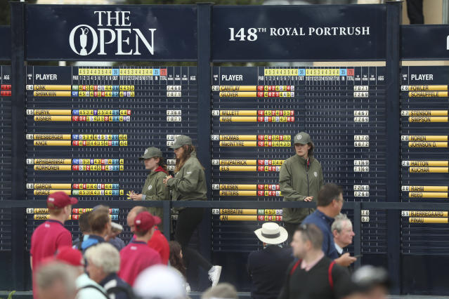 Scoreboard operators keep the spectators up to date with golfers scores during the third round of the British Open Golf Championships at Royal Portrush in Northern Ireland, Saturday, July 20, 2019.(AP Photo/Jon Super)