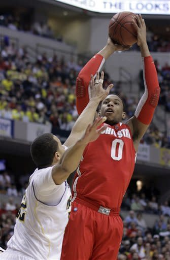 Ohio State forward Jared Sullinger (0) goes up for a shot over Michigan forward Jordan Morgan in the first half of an NCAA college basketball game in the semifinals of the Big Ten Conference tournament in Indianapolis, Saturday, March 10, 2012. (AP Photo/Michael Conroy)