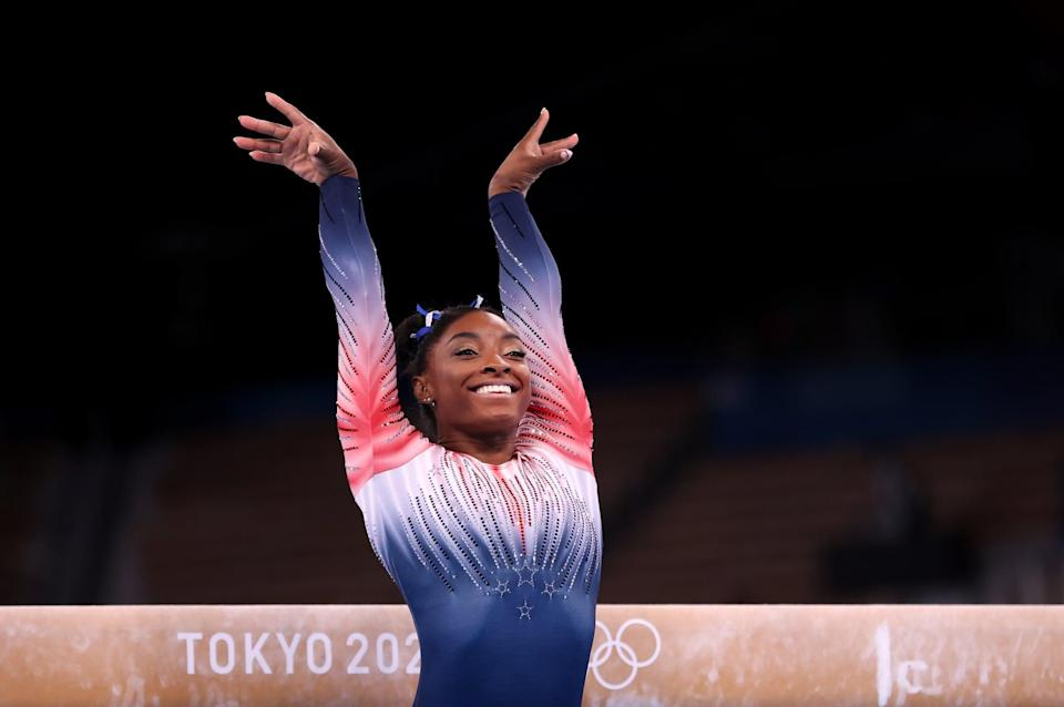 """<p>Simone Biles is undeniably the greatest gymnast of all time, but this year, her advocacy took center stage, cementing a legacy far greater than any gold, silver, or bronze medal (and <a href=""""http://www.popsugar.com/fitness/how-many-olympic-medals-has-simone-biles-won-47158189"""" class=""""link rapid-noclick-resp"""" rel=""""nofollow noopener"""" target=""""_blank"""" data-ylk=""""slk:she has plenty"""">she has plenty</a> of those, too). This <a class=""""link rapid-noclick-resp"""" href=""""https://www.popsugar.co.uk/Halloween"""" rel=""""nofollow noopener"""" target=""""_blank"""" data-ylk=""""slk:Halloween"""">Halloween</a>, rep her limited-edition red, white, and blue leotard.</p> <ul> <li><span>GK Elite Bursting Light Replica Leotard</span> ($80)</li> <li><span>SPRI Chalk Block</span> ($11)</li> <li><span>LaRibbons 1-Inch Double Face Satin Ribbon</span> ($8)</li> </ul>"""