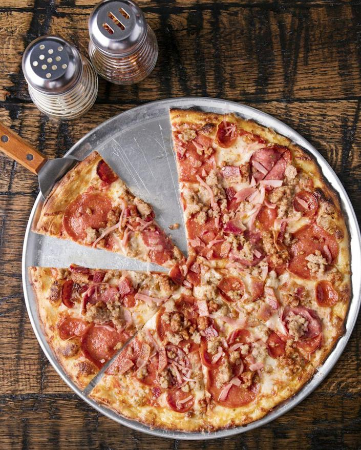 """<p>Kick your pizza game up a notch by making a meat lovers' pie. Include pepperoni, ham, sausage, salami, and bacon.</p><p><a href=""""https://www.thepioneerwoman.com/food-cooking/recipes/a36080987/lots-of-meat-pizza-recipe/"""" rel=""""nofollow noopener"""" target=""""_blank"""" data-ylk=""""slk:Get the recipe."""" class=""""link rapid-noclick-resp""""><strong>Get the recipe.</strong></a></p><p><a class=""""link rapid-noclick-resp"""" href=""""https://go.redirectingat.com?id=74968X1596630&url=https%3A%2F%2Fwww.walmart.com%2Fsearch%2F%3Fquery%3Dpizza%2Bwheel&sref=https%3A%2F%2Fwww.thepioneerwoman.com%2Ffood-cooking%2Fmeals-menus%2Fg32933285%2Fcomfort-food-recipes%2F"""" rel=""""nofollow noopener"""" target=""""_blank"""" data-ylk=""""slk:SHOP PIZZA WHEELS"""">SHOP PIZZA WHEELS</a></p>"""