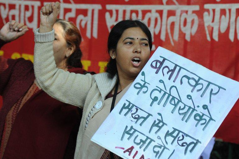 Indian women shout slogans during a protest following the gang-rape of a student in New Delhi on December 18, 2012