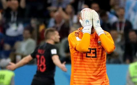 Willy Caballero holds his head in his hands after gifting Croatia their first goal - Credit: REUTERS/Ivan Alvarado