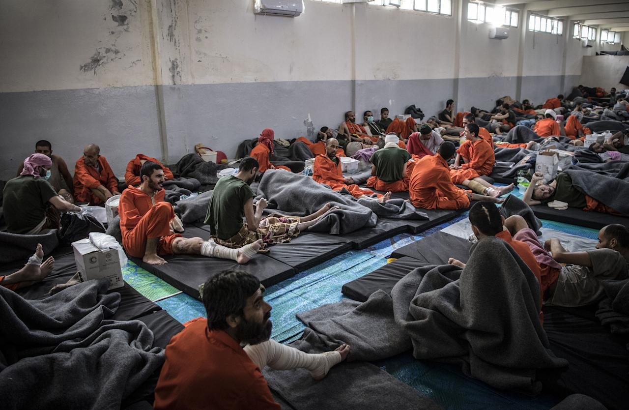 Kurdish sources say around 12,000 Isis fighters including Syrians, Iraqis as well as foreigners from 54 countries are being held in Kurdish-run prisons in northern Syria (Picture: AFP)