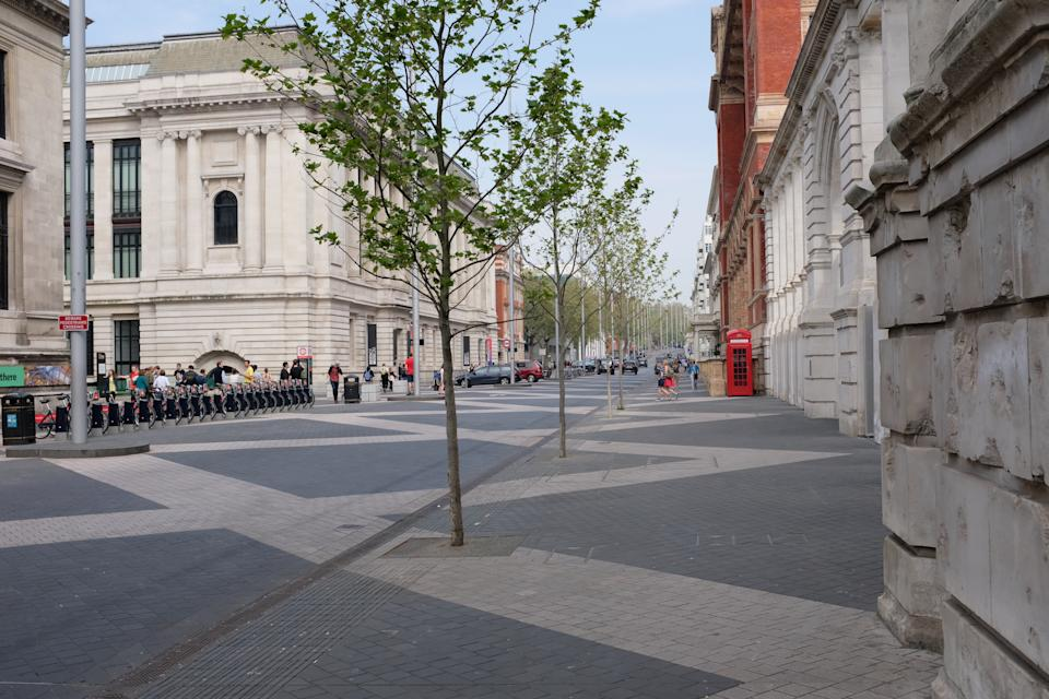 London, England - April 22, 2019: this famous street is home to the Science Museum (on the left), the Victoria & Albert Museum (on the right), the Natural History Museum, Imperial College London, and the Royal Geographical Society among other organisations.  It reopened in 2012 after a three-year, £30 million redevelopment, designed to create a 'shared space' for pedestrians and vehicles; it remains a controversial piece of town planning, continuing to divide opinion mainly on the basis of road safety concerns.  The street takes its name from the Great Exhibition of 1851, held at the northern end of the road in Hyde Park, and is in the heart of the area originally known as Albertopolis (named after Prince Albert).