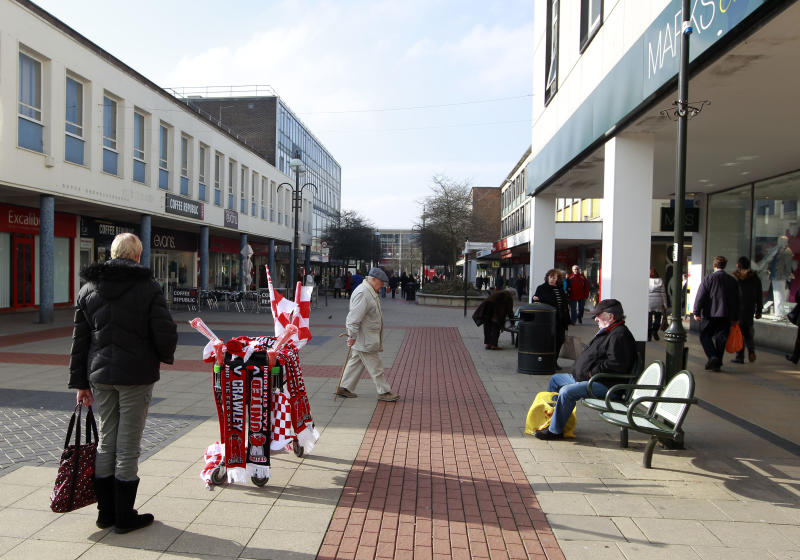 A trolley of Crawley Town Football Club souvenirs is seen in the centre of Crawley, south of England February 17, 2011. Crawley Town are due to play Manchester United in the fifth round of The FA Cup at Old Trafford next Saturday. REUTERS/Eddie Keogh (BRITAIN - Tags: SPORT SOCCER)
