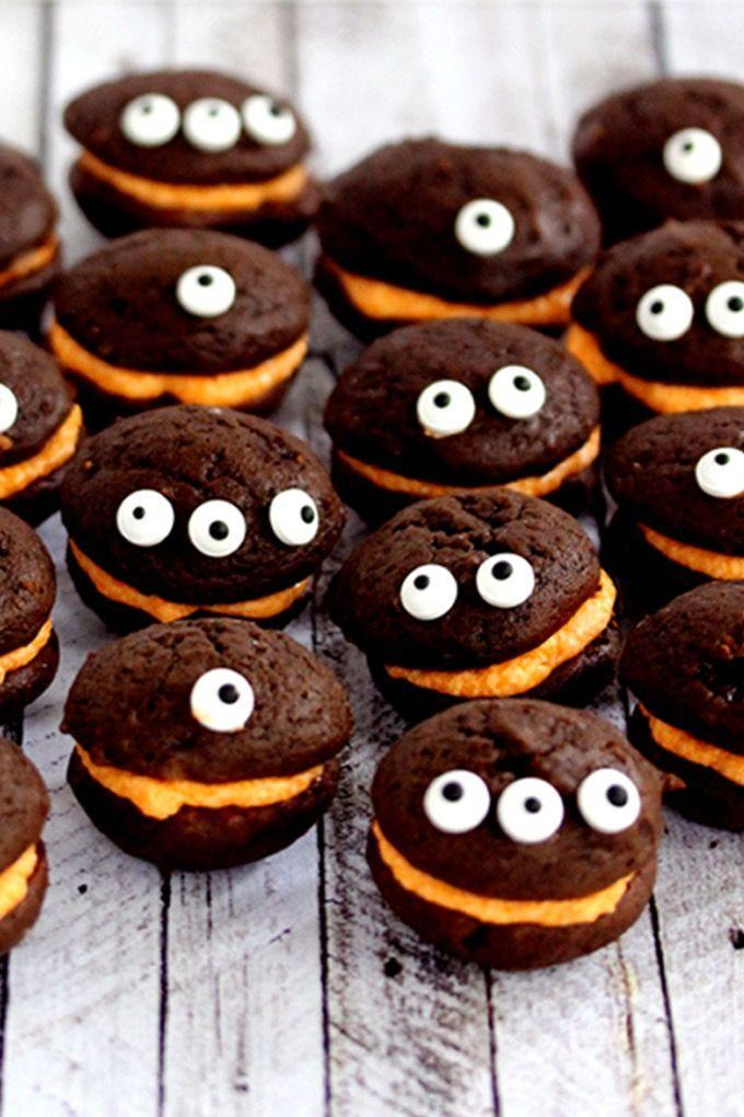 """<p>Orange cream filling makes these chocolate whoopies the perfect centerpiece for your Halloween table. And candy eyes are definitely required! </p><p><a class=""""link rapid-noclick-resp"""" href=""""https://melaniemakes.com/mini-monster-chocolate-whoopie-pies-with-orange-cream-filling/"""" rel=""""nofollow noopener"""" target=""""_blank"""" data-ylk=""""slk:GET THE RECIPE"""">GET THE RECIPE</a></p>"""