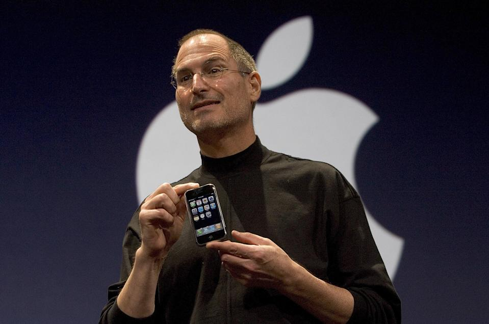 Apple CEO Steve Jobs holds up the new iPhone that was introduced at Macworld on January 9, 2007 in San Francisco, California. (Photo: David Paul Morris/Getty Images)