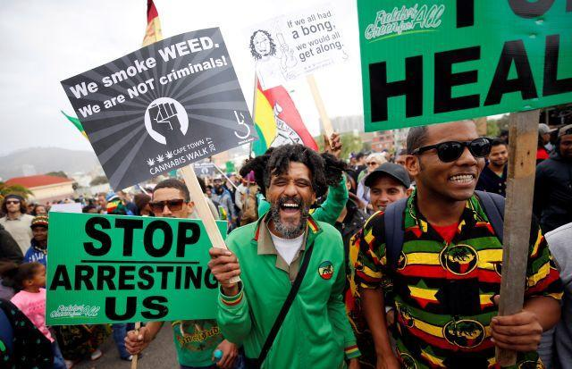 Demonstrators hold placards during a 2017 march calling for the legalization of cannabis in South Africa.
