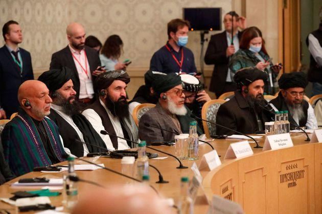 Former Afghan president Hamid Karzai (L) and Taliban co-founder Mullah Abdul Ghani Baradar (2R) attend an international conference on Afghanistan. March 18, 2021. (Photo by ALEXANDER ZEMLIANICHENKO/POOL/AFP via Getty Images) (Photo: ALEXANDER ZEMLIANICHENKO via Getty Images)