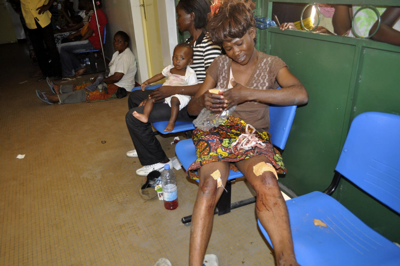 Injured people are treated in a hospital hallway after multiple explosions occurred at a munitions depot, in Brazzaville, Republic of Congo Sunday, March 4, 2012. Blasts rocked the capital of the Republic of Congo Sunday morning after a weapons depot caught fire, officials said, killing more than 200, wounding unknown numbers, and forcing 2,000 to flee their homes.(AP Photo/Elie Mbena)