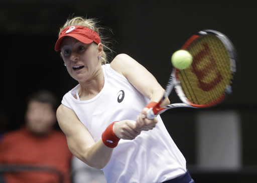 United States' Alison Riske returns the ball to Italy's Karin Knapp during a Fed Cup world group tennis match on Sunday, Feb. 9, 2014, in Cleveland. Knapp defeated Riske 6-3, 7-5. (AP Photo/Tony Dejak)