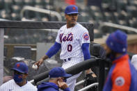 New York Mets starting pitcher Marcus Stroman leaves the field at the start of a rain delay during the first inning of a baseball game against the Miami Marlins at Citi Field, Sunday, April 11, 2021, in New York. The game was delayed at the top of the first inning due to rain. (AP Photo/Seth Wenig)