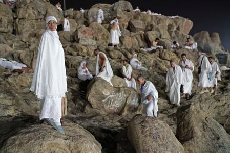 Muslim pilgrims gather on Mount Mercy on the plains of Arafat during the annual haj pilgrimage