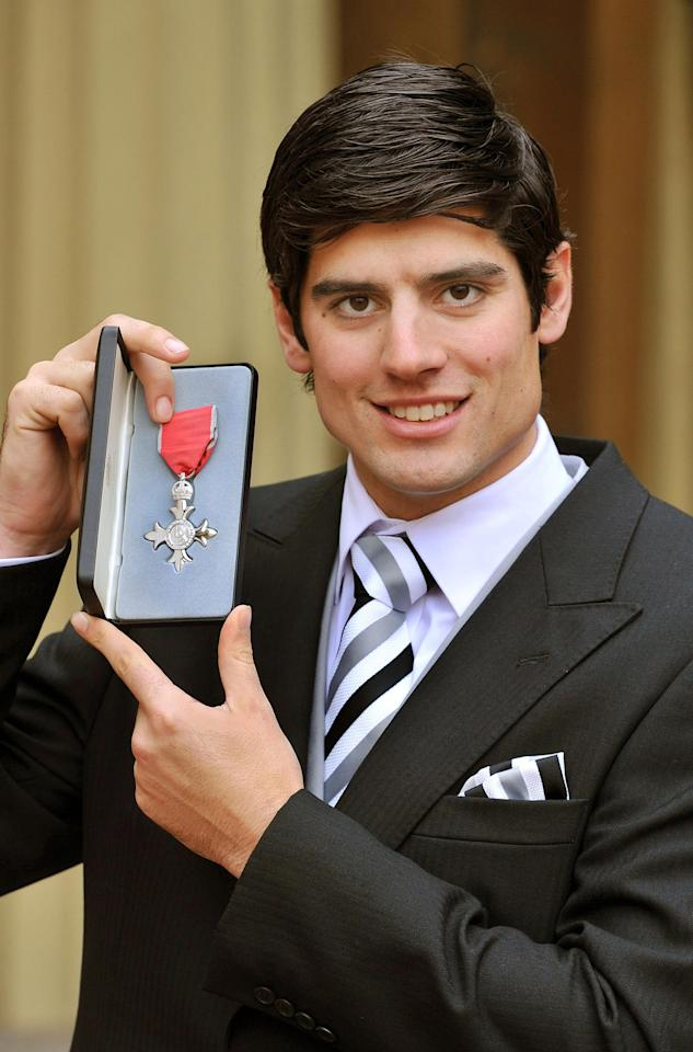 LONDON, UNITED KINGDOM - DECEMBER 6:  England cricketer Alastair Cook poses after being made an MBE by Queen Elizabeth II during an Investiture ceremony at Buckingham Palace on December 6, 2011 in London, England. (Photo by John Stillwell - WPA Pool/Getty Images)