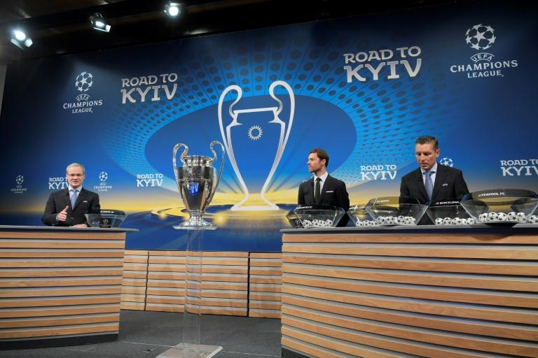 UEFA director of competitions Giorgio Marchetti (L), former Spain international Xabi Alonso (C) and UEFA head of club competitions Michael Heselschwerdt conduct the Champions League round of 16 draw at UEFA headquarters in Nyon on December 11, 2017
