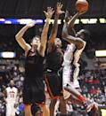 Mississippi's Jarvis Summers (32) scores over Mercer's Daniel Coursey (52) and Phillip Leonard (1) during an NCAA college basketball game in Oxford, Miss., on Sunday, Dec. 22, 2013. Mercer won 79-76. (AP Photo/Oxford Eagle, Bruce Newman)