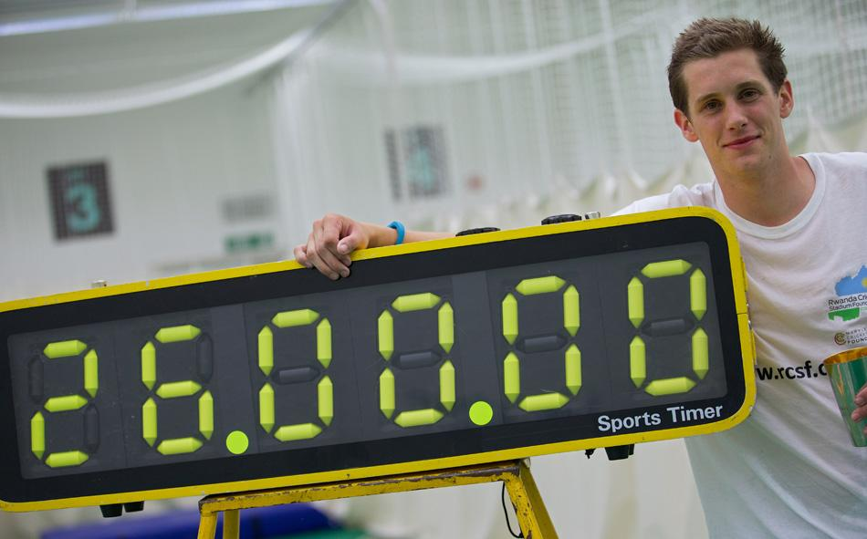 Alby Shale poses next to a timer after batting for 26 hours at the Oval cricket club in London, on July 16, 2013. A British graduate collapsed in a heap on Tuesday at The Oval cricket ground in London after batting for 26 hours in a bid to break the world record. The attempt was in aid of the Rwanda Cricket Stadium Foundation -- a charity set up to build the first proper cricket ground in the African country. AFP PHOTO / ANDREW COWIE