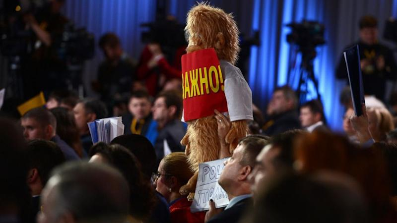 Putin's Press Uses Signs, Teddy Bears and a Yeti to Get His Attention