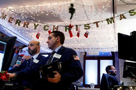 Traders work inside a post on the floor of the NYSE in New York