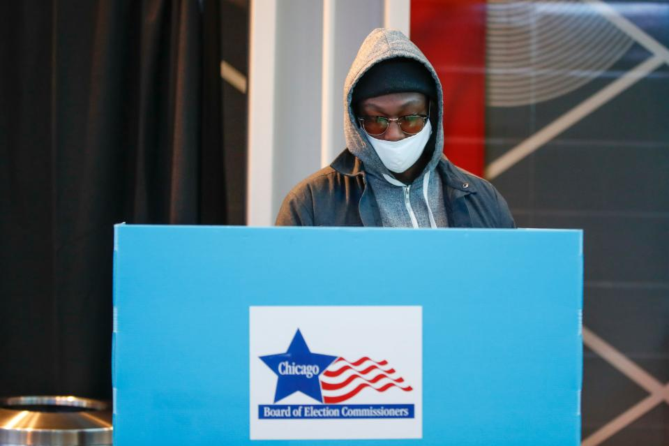 A man casts his ballot at the United Center on Election Day in Chicago, Illinois, on November 3, 2020. - Americans were voting on Tuesday under the shadow of a surging coronavirus pandemic to decide whether to reelect Republican Donald Trump, one of the most polarizing presidents in US history, or send Democrat Joe Biden to the White House. (Photo by KAMIL KRZACZYNSKI / AFP) (Photo by KAMIL KRZACZYNSKI/AFP via Getty Images)